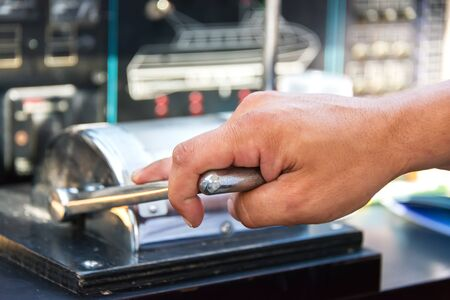Captain hand on throttle lever on motor boat photo