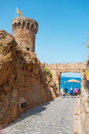 Fortress among rocks in Tossa de Mar, Costa Brava, Spain photo