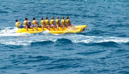 Banana boat in sea. Group of people riding banana boat Stok Fotoğraf