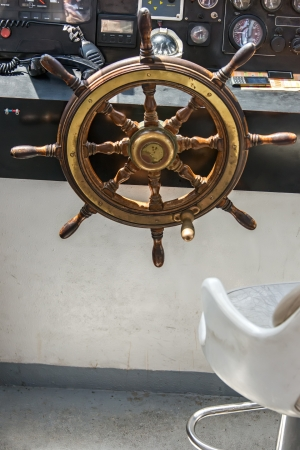 Steering wheel on motor boat photo