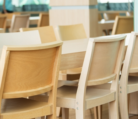 Wooden chairs at airport photo