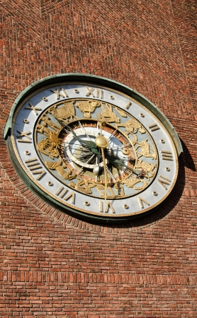 Astronomical clock on wall City Hall  Radhuset  Oslo, Norway photo