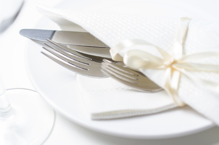 Knife with a forks, plate and glass. Place setting for a dinner at the restaurant. photo