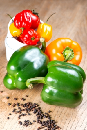 tex: Peppers on old wooden table Stock Photo