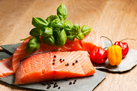 un cook: Salmon fillet on flat rocks ready to cook Stock Photo