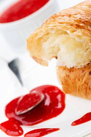danish puff pastry: Croissant and strawberry jam