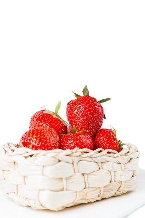 Box of strawberries, ripe with stems