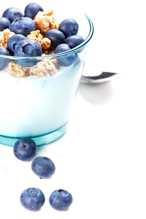 Glass of yoghurt with muesli and blueberries for healthy breakfast
