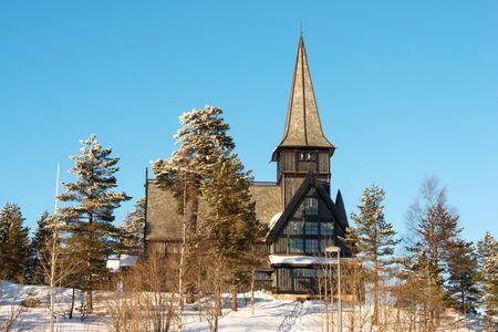 Old Holmenkollen chapel on sunny winter day photo