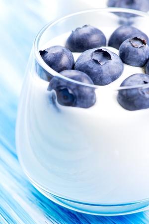 Tasty fresh blueberry yoghurt shake dessert on table photo