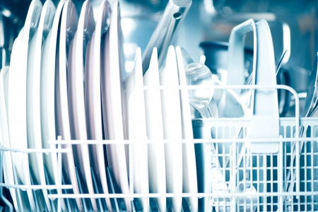 Clean dishes in dishwasher Stock Photo
