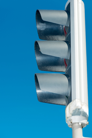 Traffic light side view on blue sky  photo