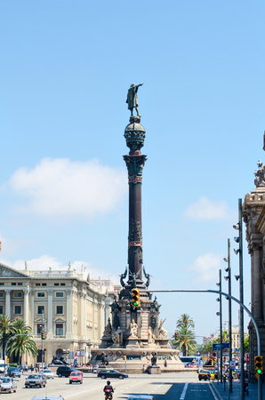 columb: BARCELONA, SPAIN - JULY 19: Tourists walking near Columbus monument in July 19, 2012 in Barcelona, Spain. Columbus Monument is 60 m. It is located at finish La Rambla and built in 1888 Editorial