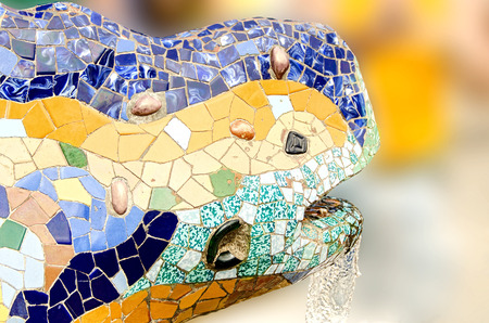 Fountain mosaic salamander head in the park Guell in Barcelona. Spain photo