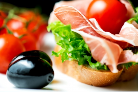 Sandwich with prosciutto on plate