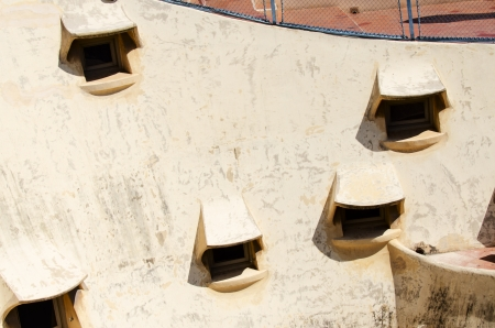 famous building: BARCELONA, SPAIN - JULY 19: Details of Casa Mila, or La Pedrera, on July 19, 2012 in Barcelona, Spain. This famous building was designed by Antoni Gaudi Editorial