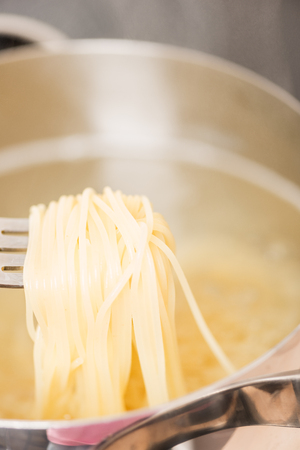 Spaghetti in pan cooking photo