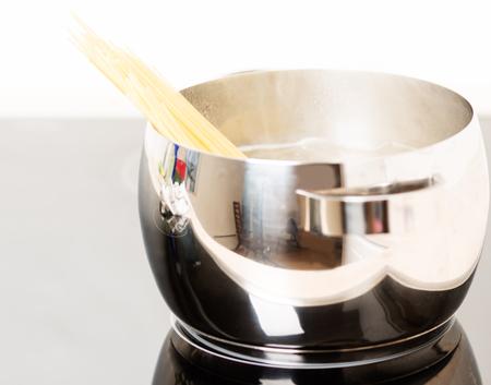 Spaghetti in pan cooking photo