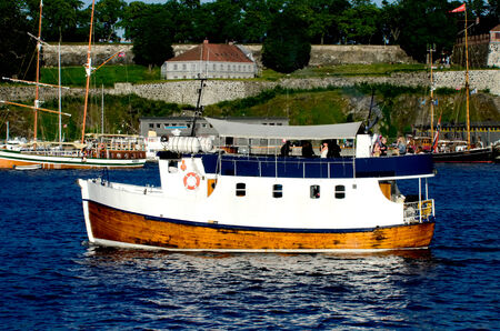 Boat with Akershus Fortress on background, Oslo, Norway