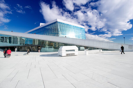 OSLO, NORWAY - SEPTEMBER 5: National Oslo Opera House shines at sunrise on September 5, 2012. Oslo Opera House was opened on April 12, 2008 in Oslo, Norway