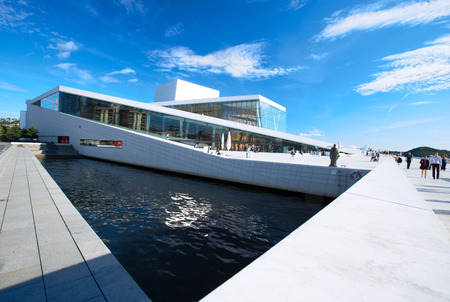 OSLO, NORWAY - AUGUST 11: National Oslo Opera House shines at sunrise on August 11, 2012. Oslo Opera House was opened on April 12, 2008 in Oslo, Norway