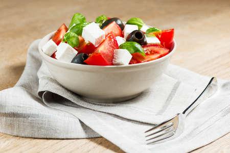 greek salad: Greek salad in bowl on wooden table