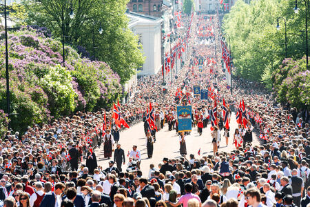 each year: OSLO - MAY 17: Norwegian Constitution Day is the National Day of Norway and is an official national holiday observed on May 17 each year. Pictured on May 17, 2014 Editorial