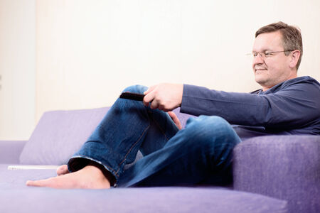 flicking: Man with TV remote in his hand