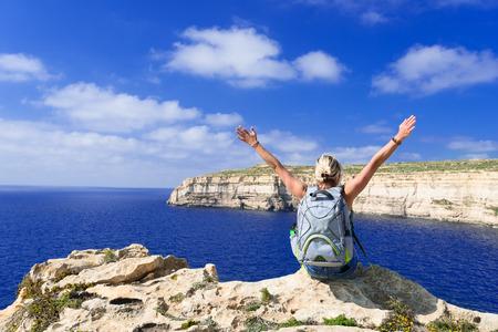 happynes: Girl looking on coast line near Azure Window on Gozo Island, Malta