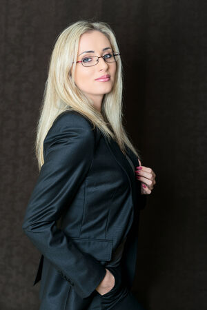 Portrait of elegantly dressed young gorgeous blond business woman. photo