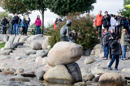 COPENHAGEN, DENMARK - SEPTEMBER 23 : Tourists taking photos of the Little Mermaid statue on the harbour front in the northern Kastellet area on September 23, 2012 in Copenhagen, Denmark