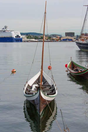 The wooden rowing and sailing boat photo