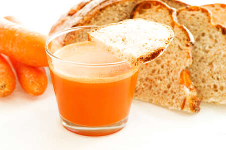 Carrot juice, carrots and carrot bread close up photo