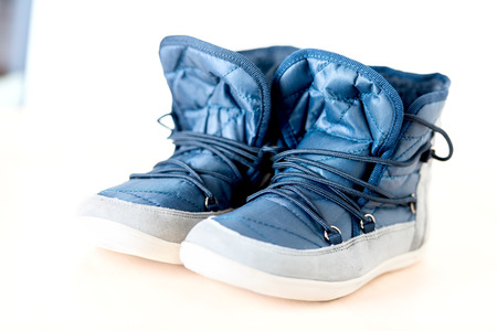 shoe string: Pair of dark blue female boots with shoe string