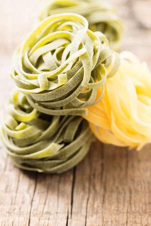 Italian pasta on wooden background photo