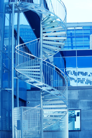 view of a staircase in a shop: Spiral staircase - emergency exit