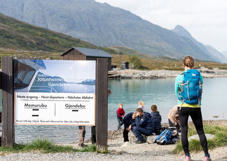 besseggen: BESSEGGEN, NORWAY - AUGUST 6: Hikers waiting for ferry. Besseggen is one of the most popular mountain hikes in Norway. About 30,000 people walk this trip each year. Editorial