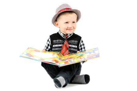 Smiling happy boy in hat and tie shot in the studio on a white background photo