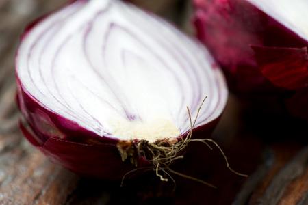 cross cut: Fresh red onion cross cut on an old wooden table
