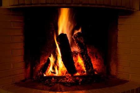 the ashes: Burning fireplace with firewood and glowing ashes Stock Photo