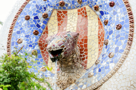 trencadi: BARCELONA, SPAIN - JULY 13: Ceramic art in Park Guell on July 13, 2012 in Barcelona, Spain. It was built in 1900-14 and is part of the UNESCO World Heritage Site Works of Antoni Gaudi. Editorial