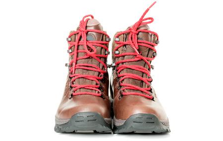 boots: Un par de botas de monta�a nuevas en el fondo blanco Foto de archivo