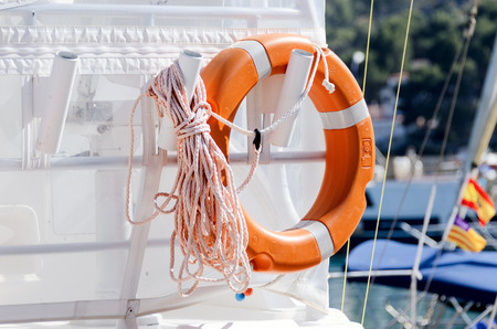 flotation: Personal flotation device on yacht aft with rope