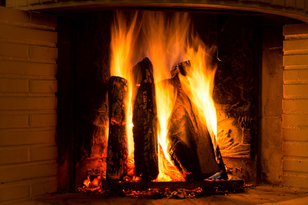 burning fireplace: Burning fireplace with firewood and glowing ashes Stock Photo