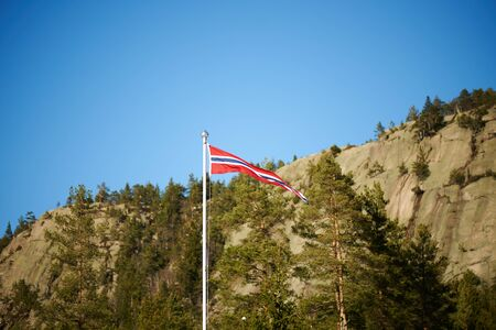 pennant: Norwegian pennant on a pole with mountains background