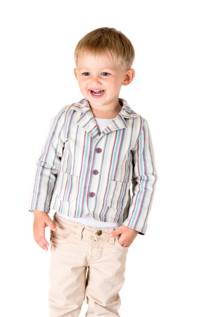 Boy in shirt shot in the studio on a white background photo