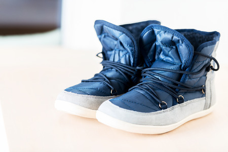 shoe strings: Pair of dark blue female boots with shoe string