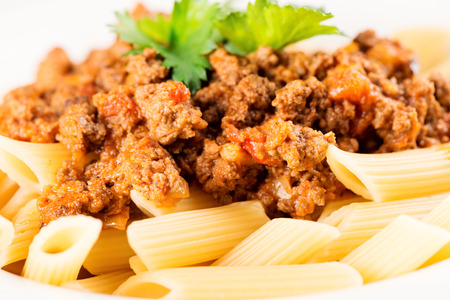 bolognese sauce: Pasta. Penne Pasta with Bolognese Sauce, Parmesan Cheese and Basil, Fork. Italian Cuisine. Mediterranean food Stock Photo