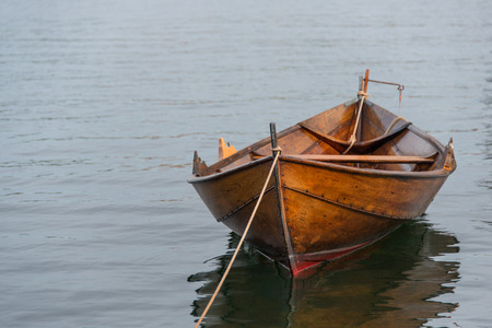 Old wooden row boat moored Stock Photo