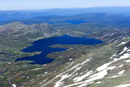 meagre: Gaustatoppen mountain at sunny summer day